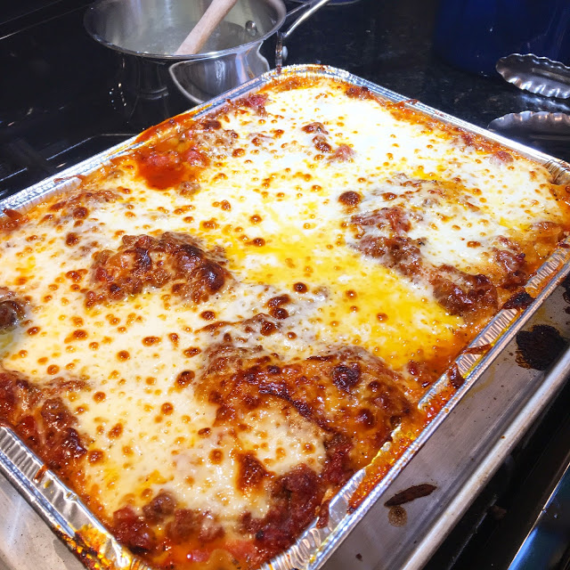 The best lasagna recipe you'll ever make using spicy sausage and smoked mozzarella for a crowd pleasing dinner recipe idea
