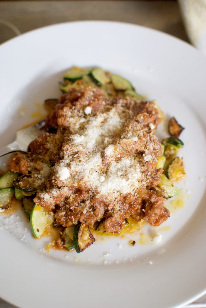 A keto dinner recipe idea! Easy spaghetti sauce served over parmesan zucchini!
