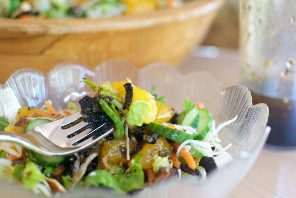 Mandarin oranges, crispy lettuce and crunchy cole slaw make slaw-lad that is the best salad recipe for summer dinners.
