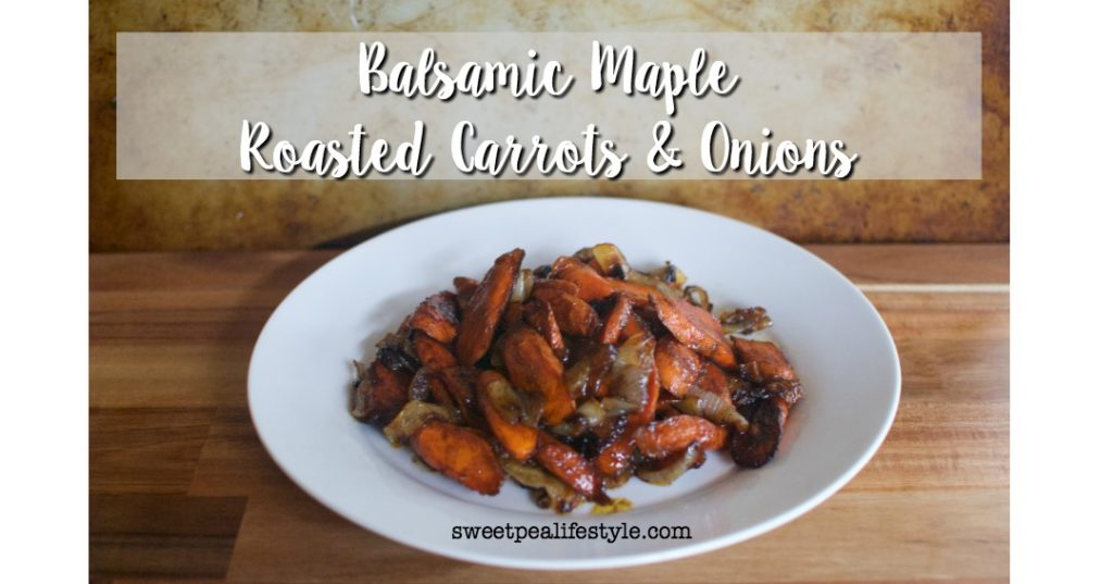 The perfect thanksgiving side dish idea using carrots and onions roasted in a balsamic maple glaze
