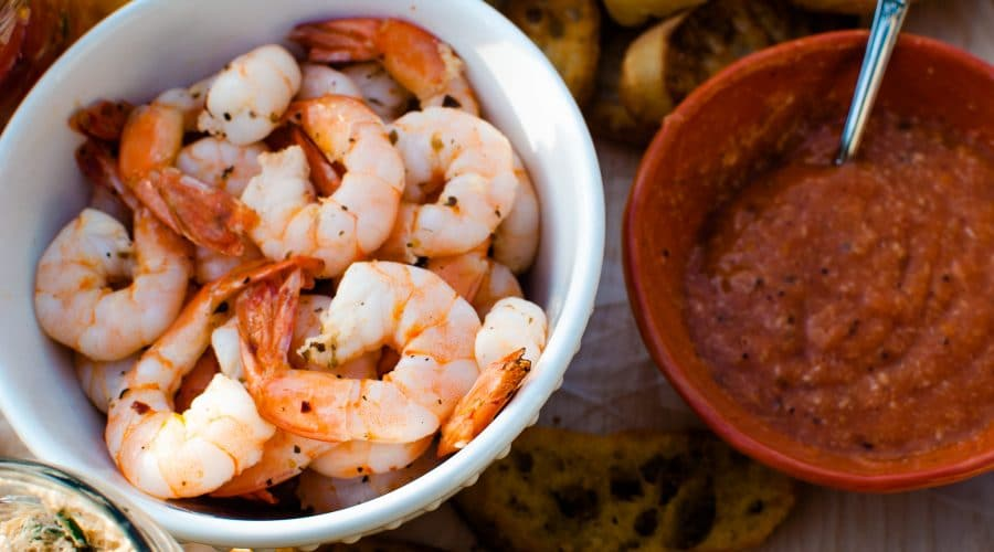 Shrimp cocktail recipe using garlic and herbs with a homemade cocktail sauce