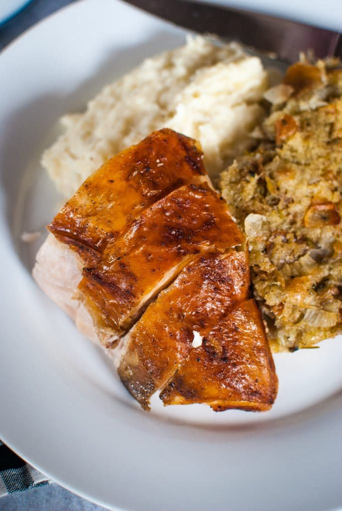 Roast Turkey Breast on a plate with side dishes