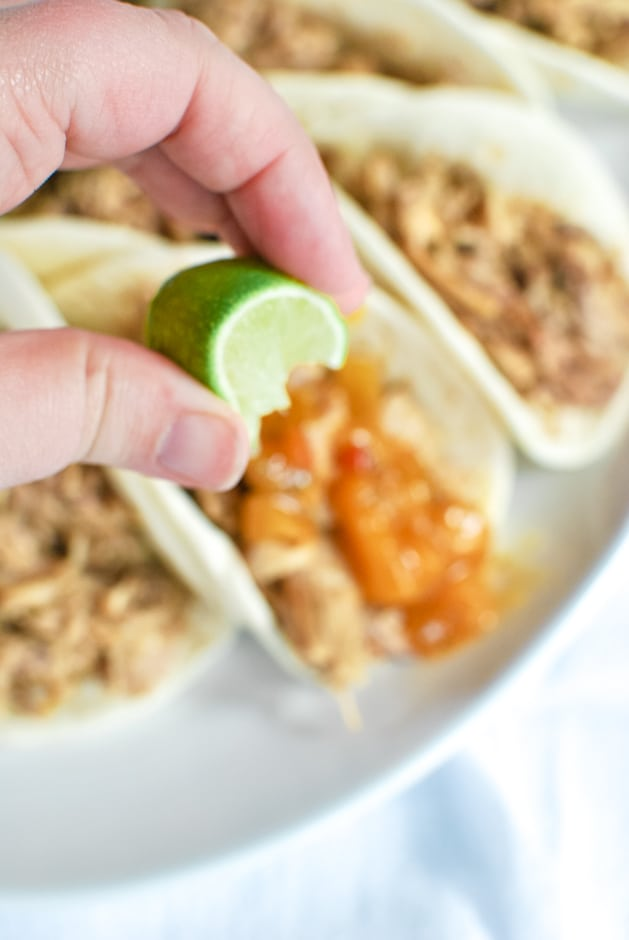 squeezing lime on a taco