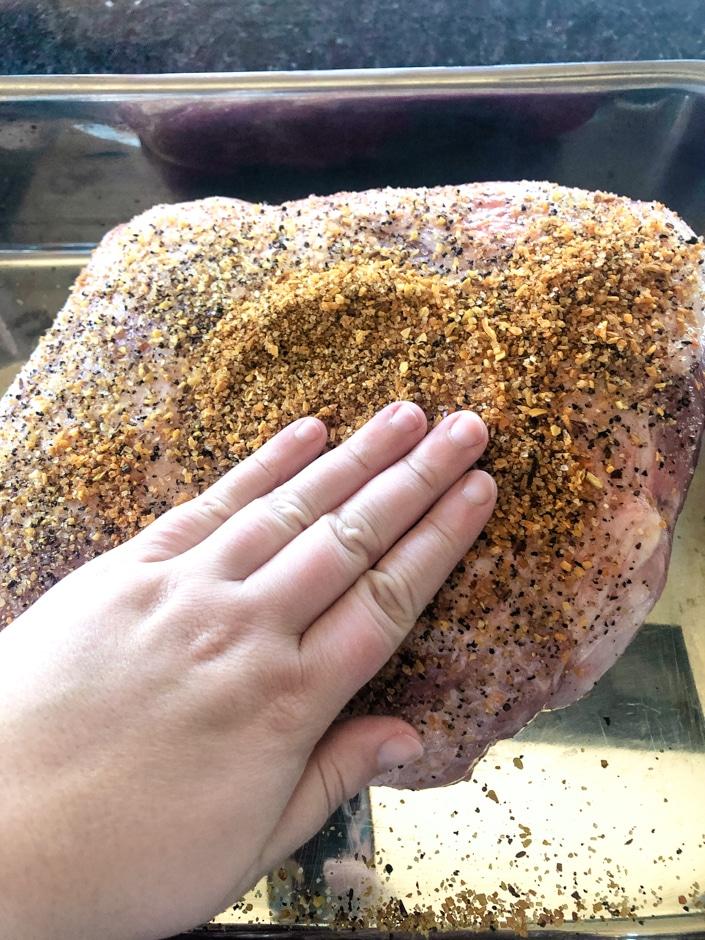Rubbing Seasoning on Pork Butt