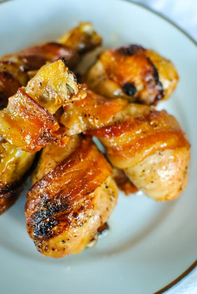 Bacon Wrapped Chicken Legs with Honey Cholula Sauce
