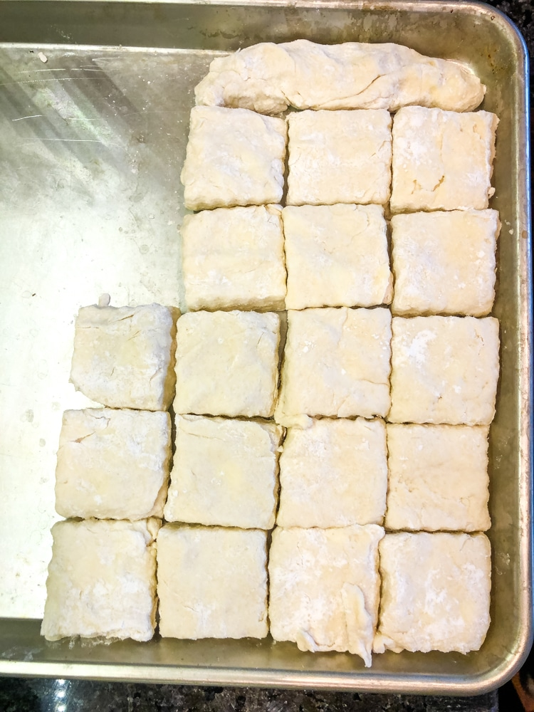 arranging biscuits to be cooked