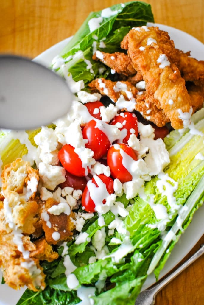 Drizzling ranch on a salad