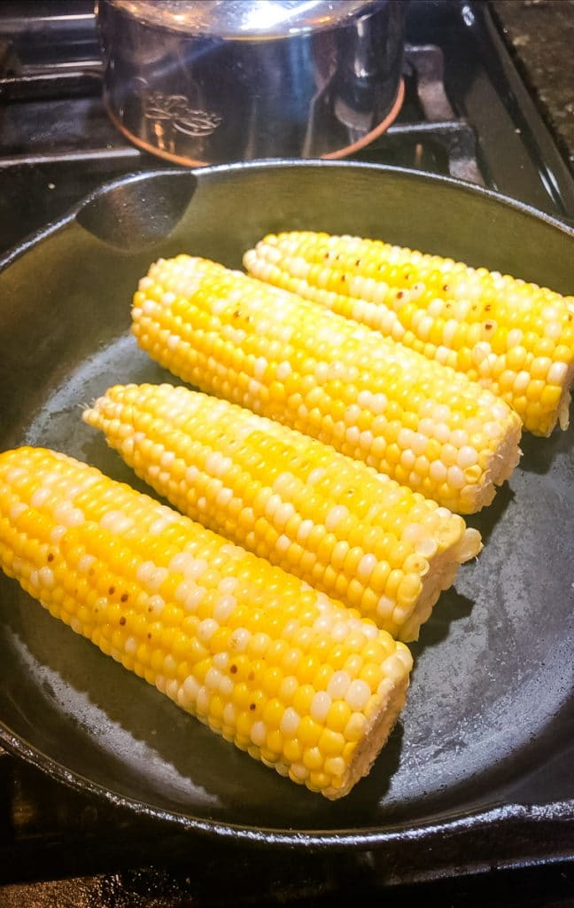 blistering corn in a cast iron skillet
