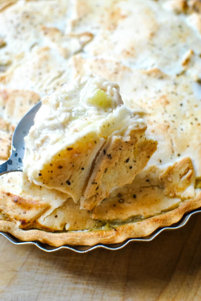 serving homemade chicken pot pie