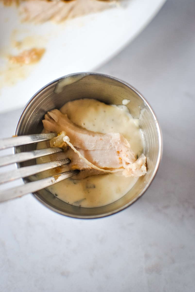 Dipping Turkey in to Garlic Mayo