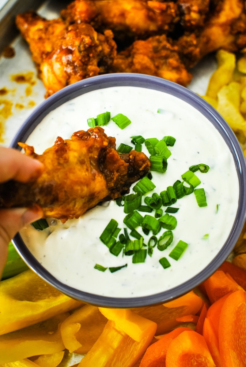 Dipping a Chicken Wing in Green Onion DIp