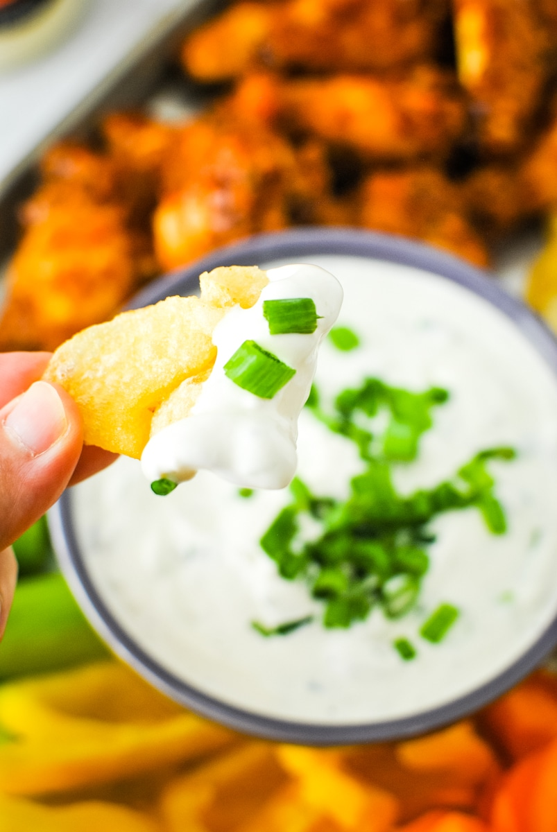 Dipping a Chip in Green Onion Dip